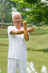 Retired Asian chinese senior man exercising in park