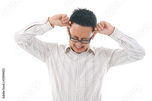 Asian business man holding his head. Conceptual image.