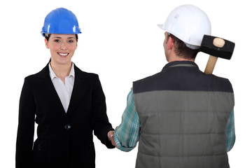 Construction manager and worker