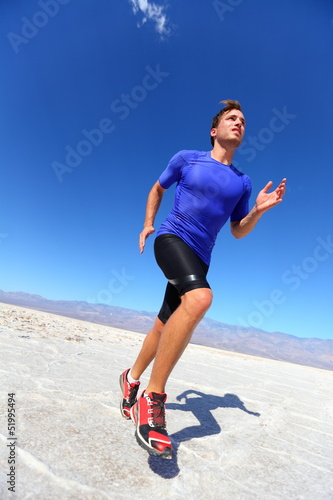 Running sport athlete man sprinting in trail run