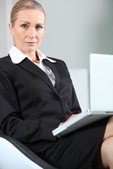 Unhappy businesswoman with laptop.