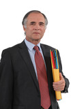 Mature businessman with a folder