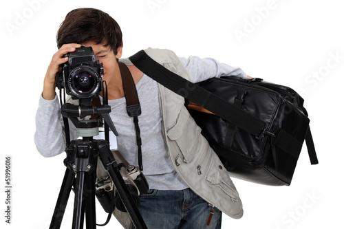 Little boy dressed as cameraman