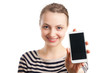 Young blond woman showing white cell phone