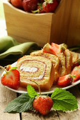 roulade cake with cream and strawberries