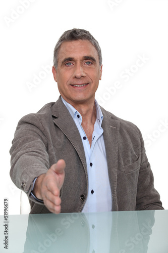 man giving his hand for a handshake