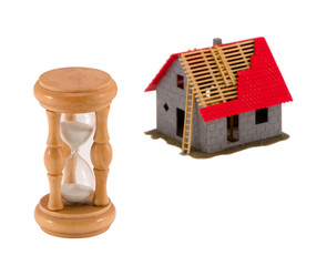 sand glass unfinished house model crisis concept