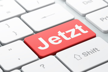 Time concept: Jetzt on computer keyboard background