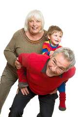 Grandparents with Grandchild on White Background - Having Fun