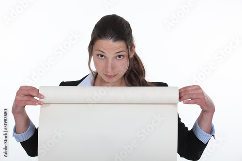 Woman holding flip-chart paper