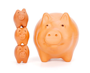 Small piggy banks superimposed near big one