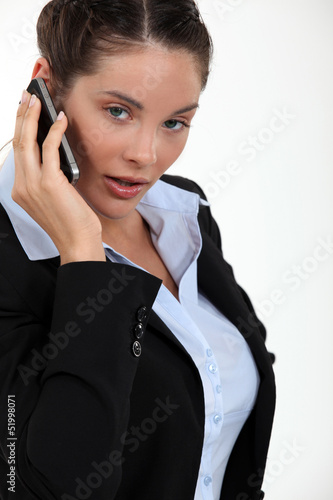 cute young businesswoman on the phone