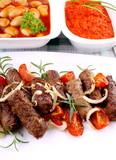 Grilled cevapcici with giant white beans and ajvar