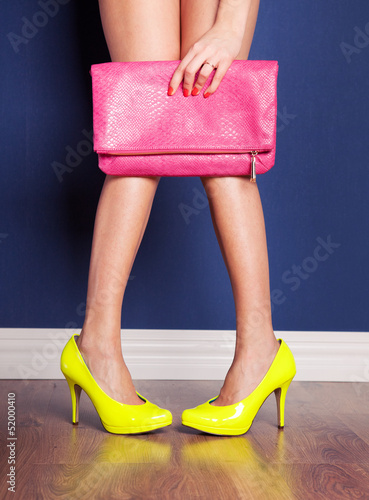 Girl wearing high heels and holding a bag