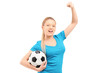 A happy female holding football and cheering