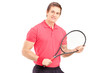 A young man holding a tennis racket