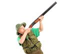 A male hunter shooting with a shotgun