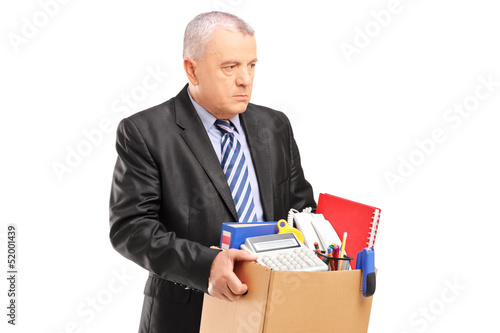 A fired professional man with a box of belongings