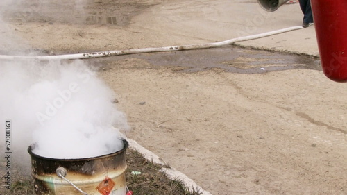Man using fire extinguisher