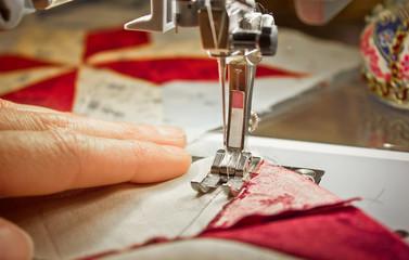 woman at a sewing machine closeup