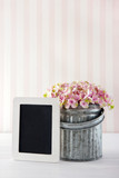 Pink hydrangea flowers with empty blackboard