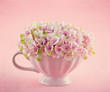 Romantic pink hydrangea flowers in a mug
