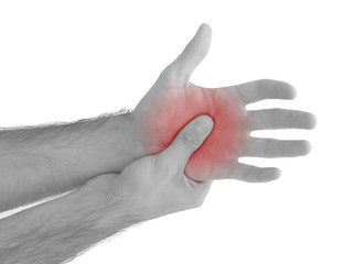 Acute pain in a man palm. Male holding hand to spot of palm-ache