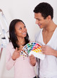 African Couple Choosing Color For New Home