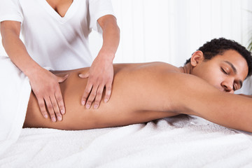 Man Receiving Massage From Female Hand