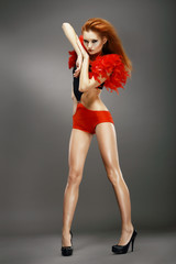 Entertainment. Redhead Asian Showgirl in Night Disco Club. Dance