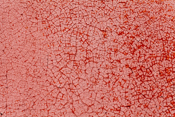 Cracked red color on metal texture