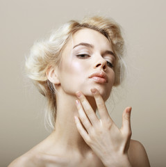 Natural Blonde Woman touching her Clean Face. Pampering