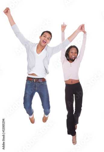 Young Couple Jumping In The Air