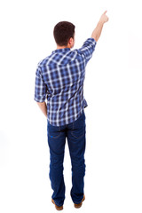 Young casual man pointing towards copyspace, isolated on a white
