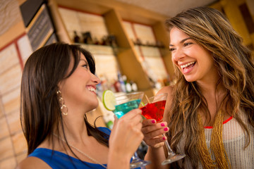 Women having at the bar