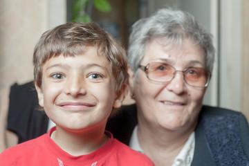 portrait of a senior woman and grandson