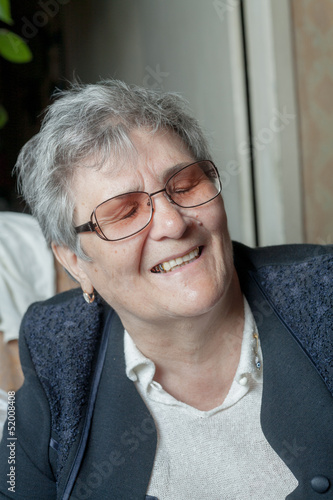 portrait of a smiling senior female closed eyes