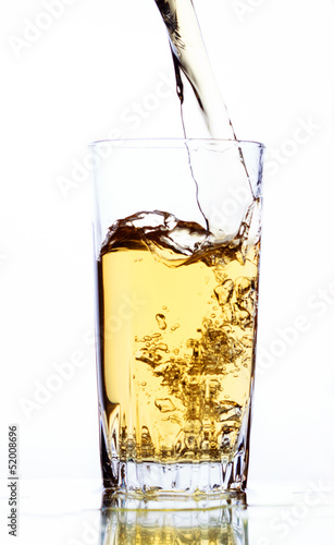 Apple juice in glass on white background