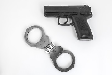 gun and handcuffs
