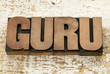 guru word in wood type