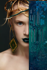 beautiful woman with motherboard