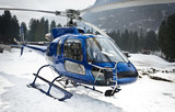 helicopter resting on the snow - front