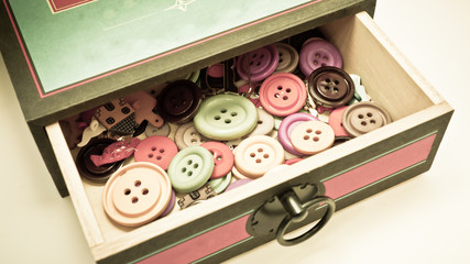 vintage box of buttons