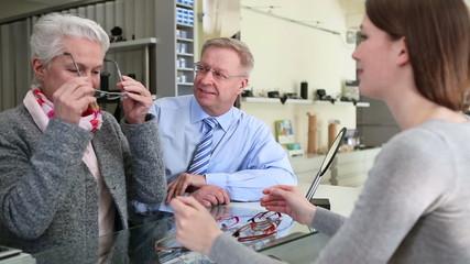 Senior couple choosing eyglasses