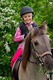 Horse riding - lovely girl is riding on a horse poster