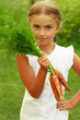 Gardening, vegetable - lovely girl with bunch of carrots