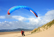paraglider landing on beach