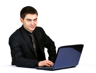 businessman with laptop on desk