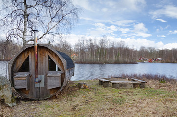 Sauna house on a lake coast