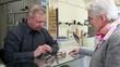 Optician selling glasses to senior woman